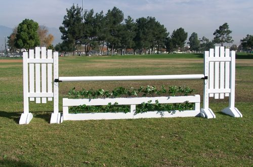 brush box in white with slant picket jump