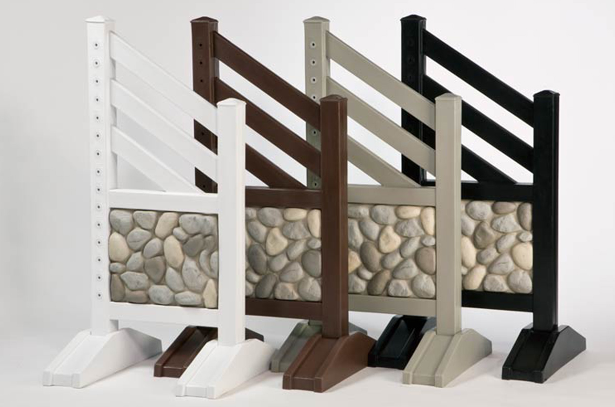stone wall jump standards with complete jump in white, brown, grey, and black