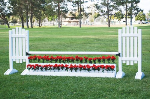 red flowers and white complete horse jump