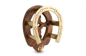 brass and wood horseshoe rack
