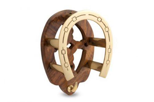 brass and wood horseshoe rack