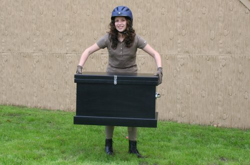 young lady holding a black starter trunk